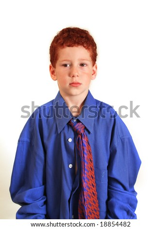 5 year old boy dressed in daddy's business attire