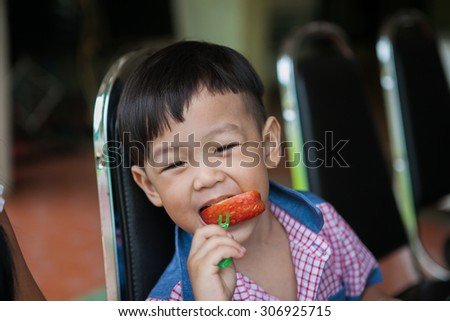 4-year-old boy in Thailand are sitting to eat fruit. - stock photo