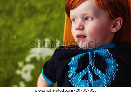4 year old boy on his balcony during sunset -- image taken outdoors in Reno, Nevada, USA - stock photo