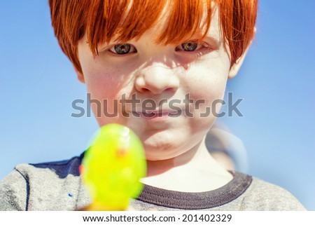 4 year old boy playing at a park -- image taken at Sparks Marina Park in Sparks, Nevada, USA - stock photo