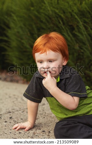 3 year old boy playing outside -- image taken outdoors in Reno, Nevada, USA