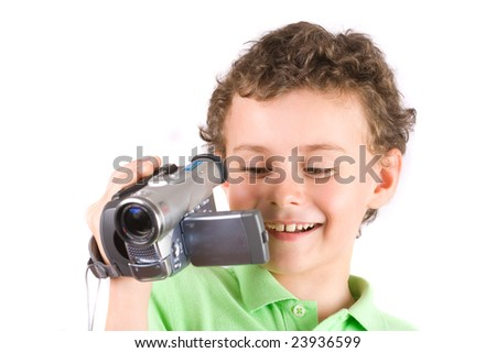 8 year old boy using video camera, isolated on white background - stock photo