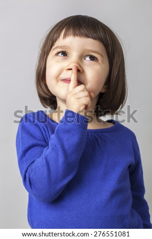 4-year old child playing with mystery and fun for joking - stock photo