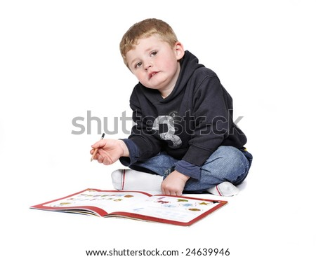 4 year old, doing preschool work. - stock photo