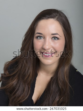 18 year old female head shot on a grey background - stock photo