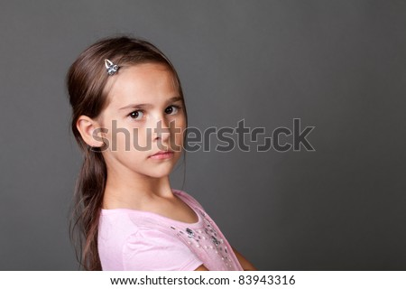 7 year old girl in casual dance outfit making faces - stock photo