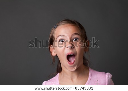 7 year old girl in casual dance outfit making faces