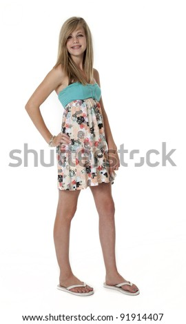 14 year old girl in summer dress on white background