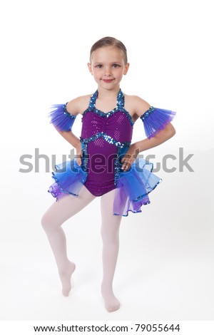 5 Year old girl with dancing costume on a white background - stock photo