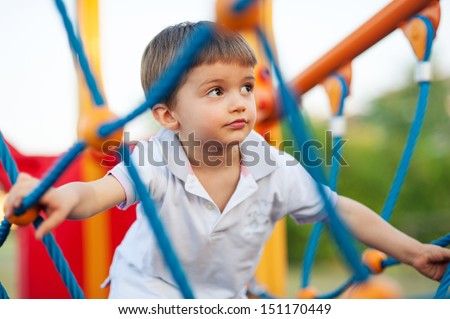 3 year old kid in a playground outdoor.  - stock photo