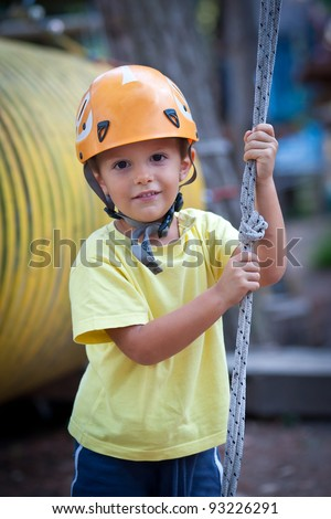 3 year old Kid with helmet. - stock photo