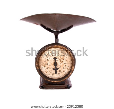 100 year old kitchen weighing scale, white iso. - stock photo