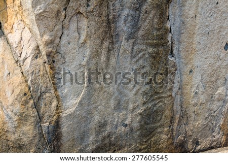 3000-year-old rock carvings on a cliff in Nam Tum in Po Toi Island in Hong Kong.  - stock photo