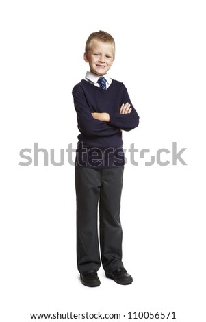 8 year old school boy arms folded on white background - stock photo