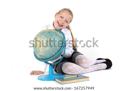 8 year old school girl with book and globe smiling on white background