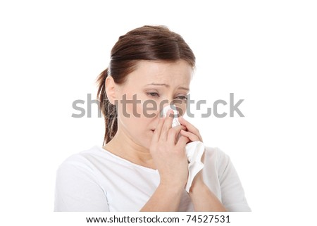 35-40 year old woman with tissue, heaving allergy or cold. Isolated on white background - stock photo