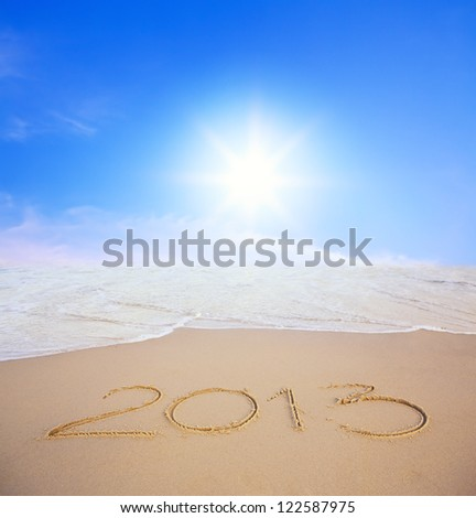2013 year on the beach with blue sky and sun - stock photo