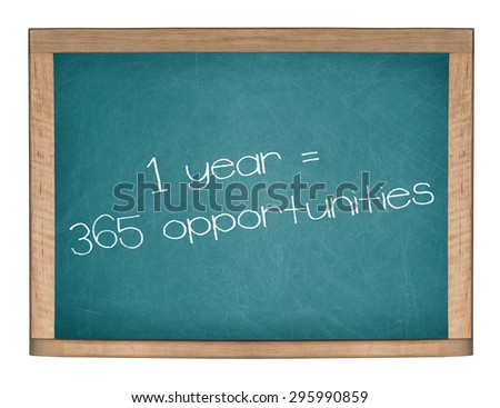 1 YEAR = 365 OPPORTUNITIES motivational quote written on a green chalkboard. - stock photo