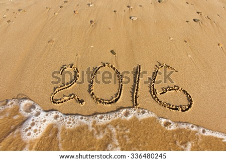 2016 year written on sandy beach sea  - stock photo