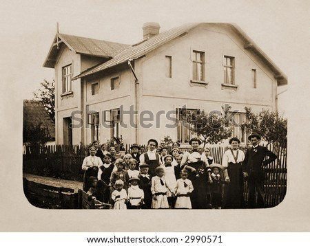 100 years ago - Very old photograph of a group of people in front of a house - stock photo
