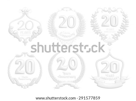 20 Years Anniversary badge set in white on isolated white background. - stock photo