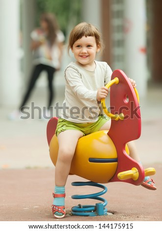 3 years baby girl  playing in playground area - stock photo