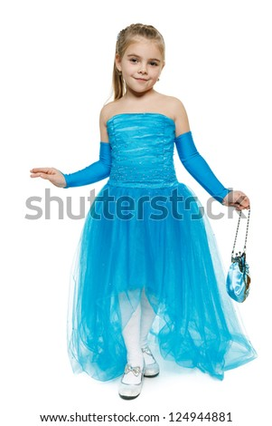 6 years girl wearing blue ball dress in full length making curtsy, over white background - stock photo