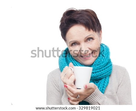 50 years old attractive woman with a white cup of tea in hand, isolated on a white background