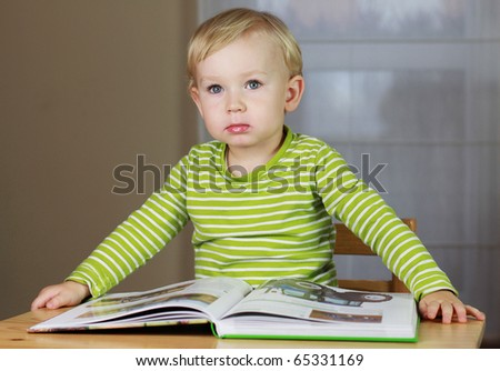 2 years old baby boy reading book - stock photo