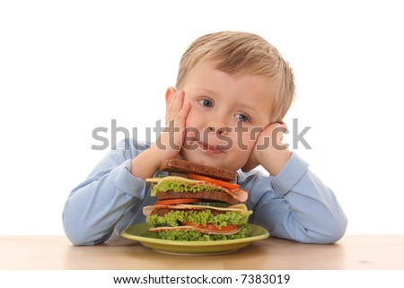 3-4 years old boy and big sandwich isolated on white - stock photo