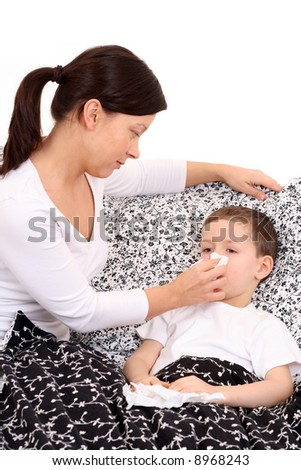 6 years old boy and his mother - flu season - stock photo