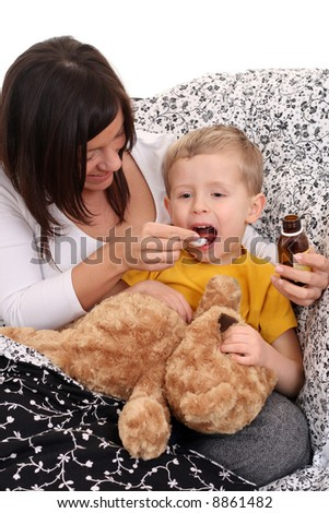 4 years old boy and his mother - flue season - stock photo