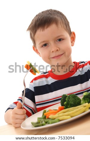 5-6 years old boy and plate of cooked vegetables isolated on white - stock photo