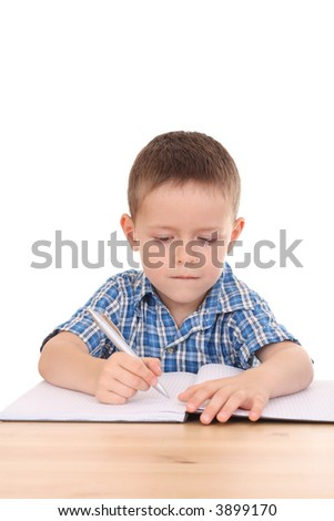 5 years old boy at desk isolated on white