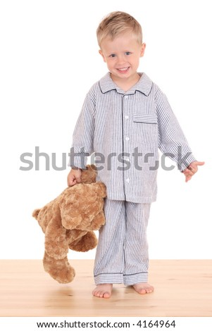 3-4 years old boy in pijama with his teddy bear isolated on white - stock photo
