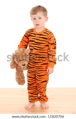 3-4 years old boy in pyjama - ready to sleep isolated on white - stock photo