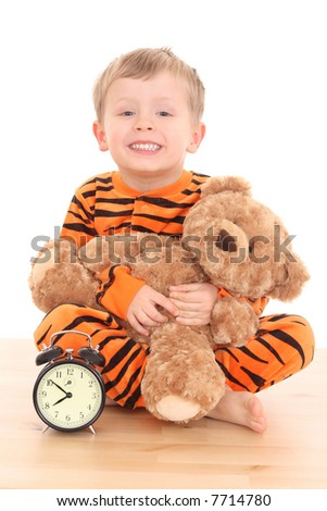 3-4 years old boy in pyjama - ready to sleep isolated on white - stock photo