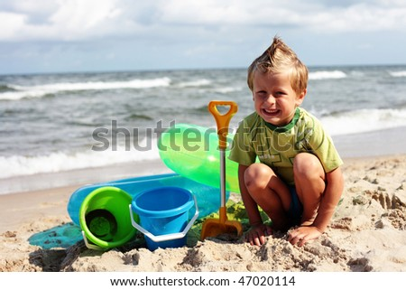 6 years old boy on the beach - kids - stock photo