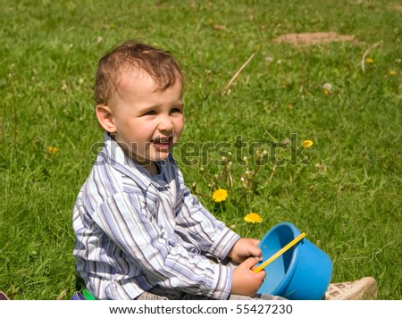 2 years old boy playing in park - stock photo