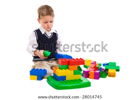 4 years old boy playing with building blocks - stock photo