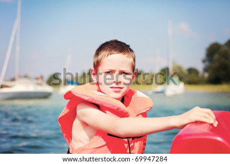 8 years old boy ready to sailing - kids - stock photo