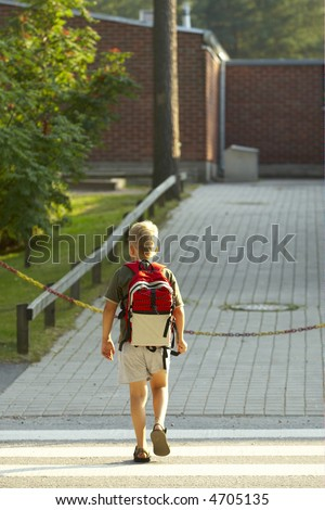 7 years old boy ready to school - stock photo