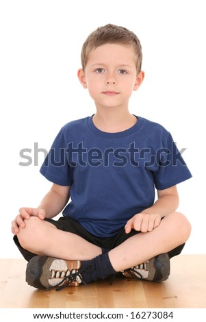 6-7 years old boy sitting isolated on white