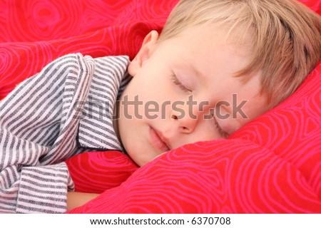 3-4 years old boy sleeping - resting - stock photo