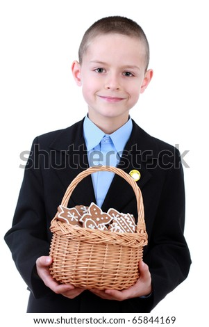8 years old boy with basket of Christmas cookies - kids