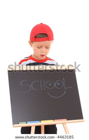 5-6 years old boy with blackboard isolated on white