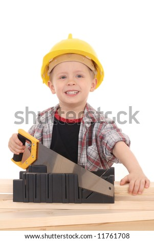 4 years old boy with handsaw isolated on white - stock photo