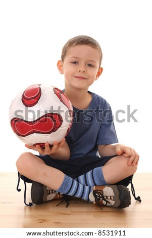 6 years old boy with soccer ball isolated on white