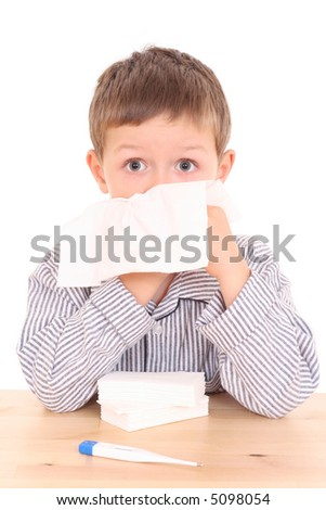 5-6 years old boy with thermometer and tissue - stock photo
