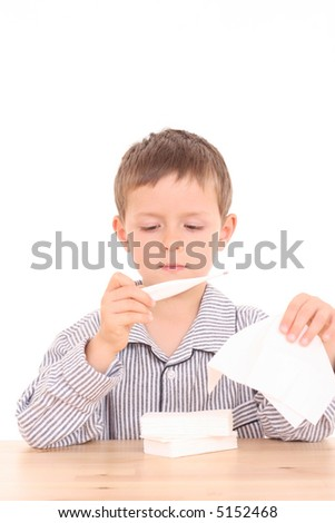 5-6 years old boy with thermometer tissue - stock photo